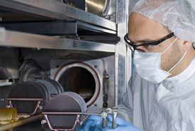 Technician Working with Silicon Wafers