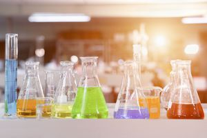 Laboratory Research - Scientific Glassware For Chemical Background for Experiments in the Chemical laboratory in science classroom interior.