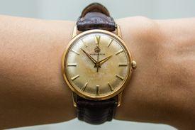 A wristwatch worn by a person
