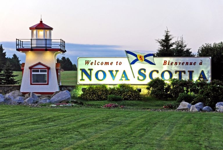 Welcome to Nova Scotia sign at twilight.