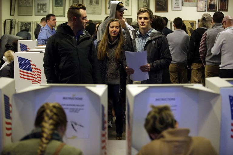 Young voters wait their turn for voting booths