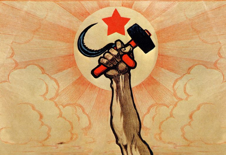 Symbols of communism: the hand wielding the hammer and sickle, in the background the rising sun and the red star.