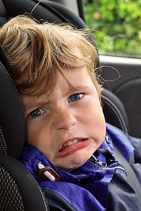 child with disgusted facial expression