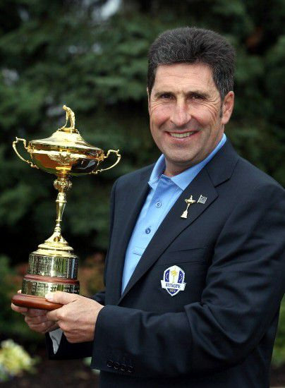 Jose Maria Olazabal posing with the Ryder Cup in 2011