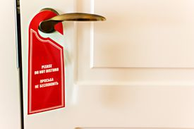 Please do not disturb sign on door in English and in Russian.