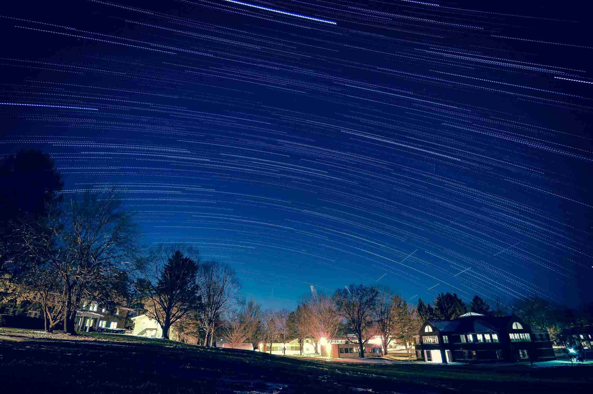 Nighttime Time Lapse photo of stars moving over Oakwood Friends School