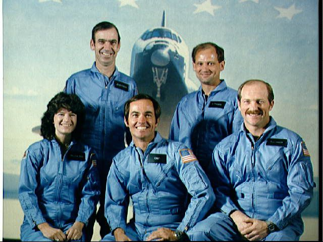 Sally Ride among the crew of STS-7, in an official crew portrait.