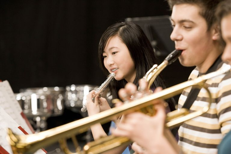 Teenagers playing in high-school band