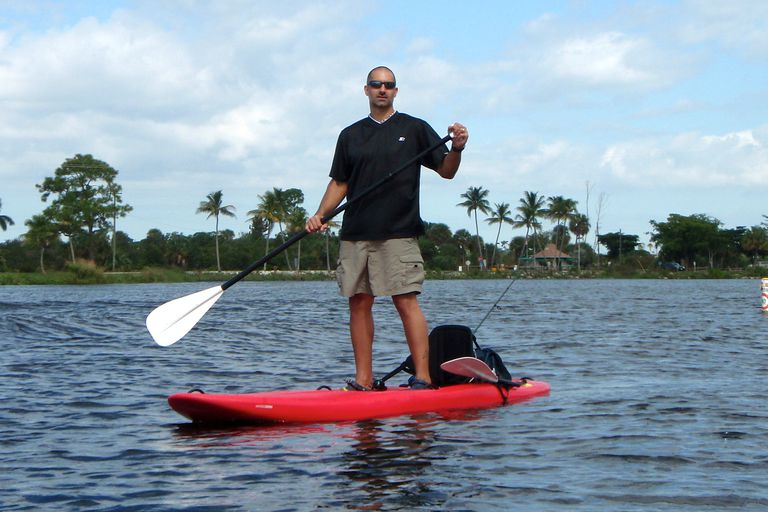 Paddling a cross between a paddleboard and a kayak.