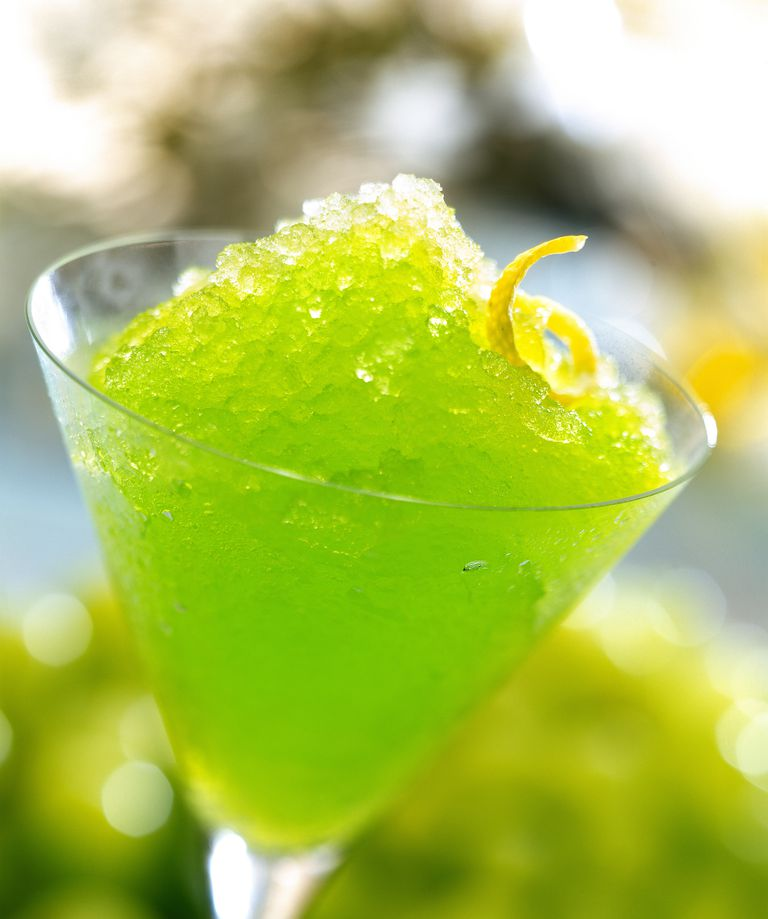 Slushy green drink in martini glass.