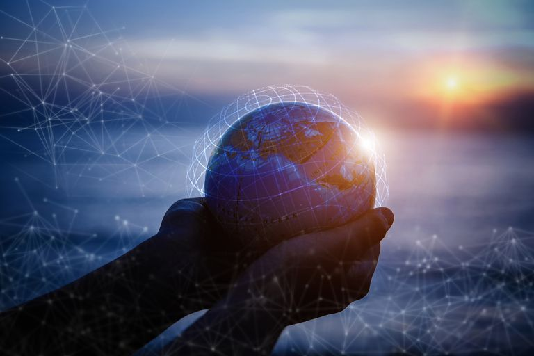 Small Hands holding the world with global connection concept.