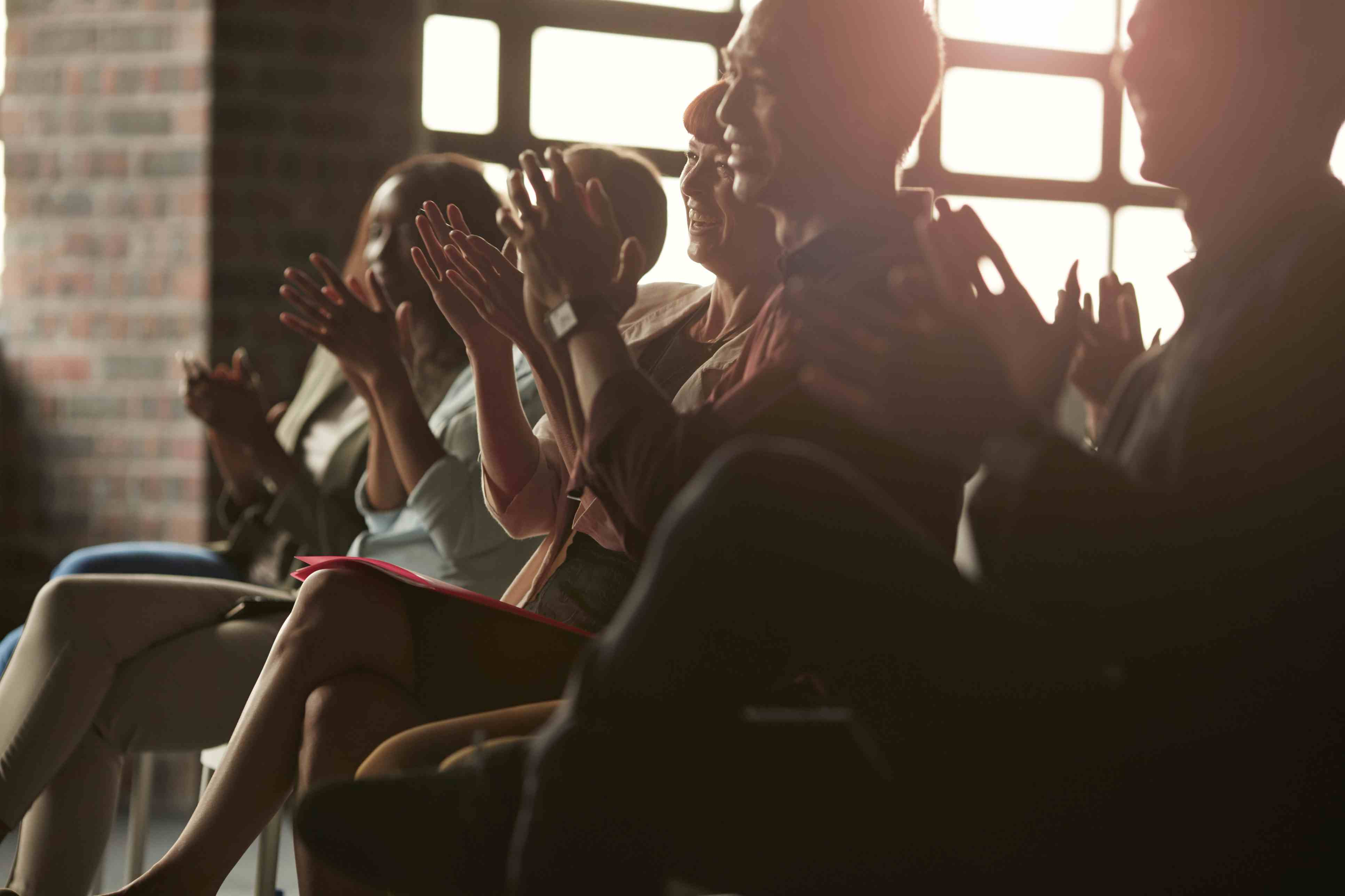 Group of businesspeople clapping at lecture