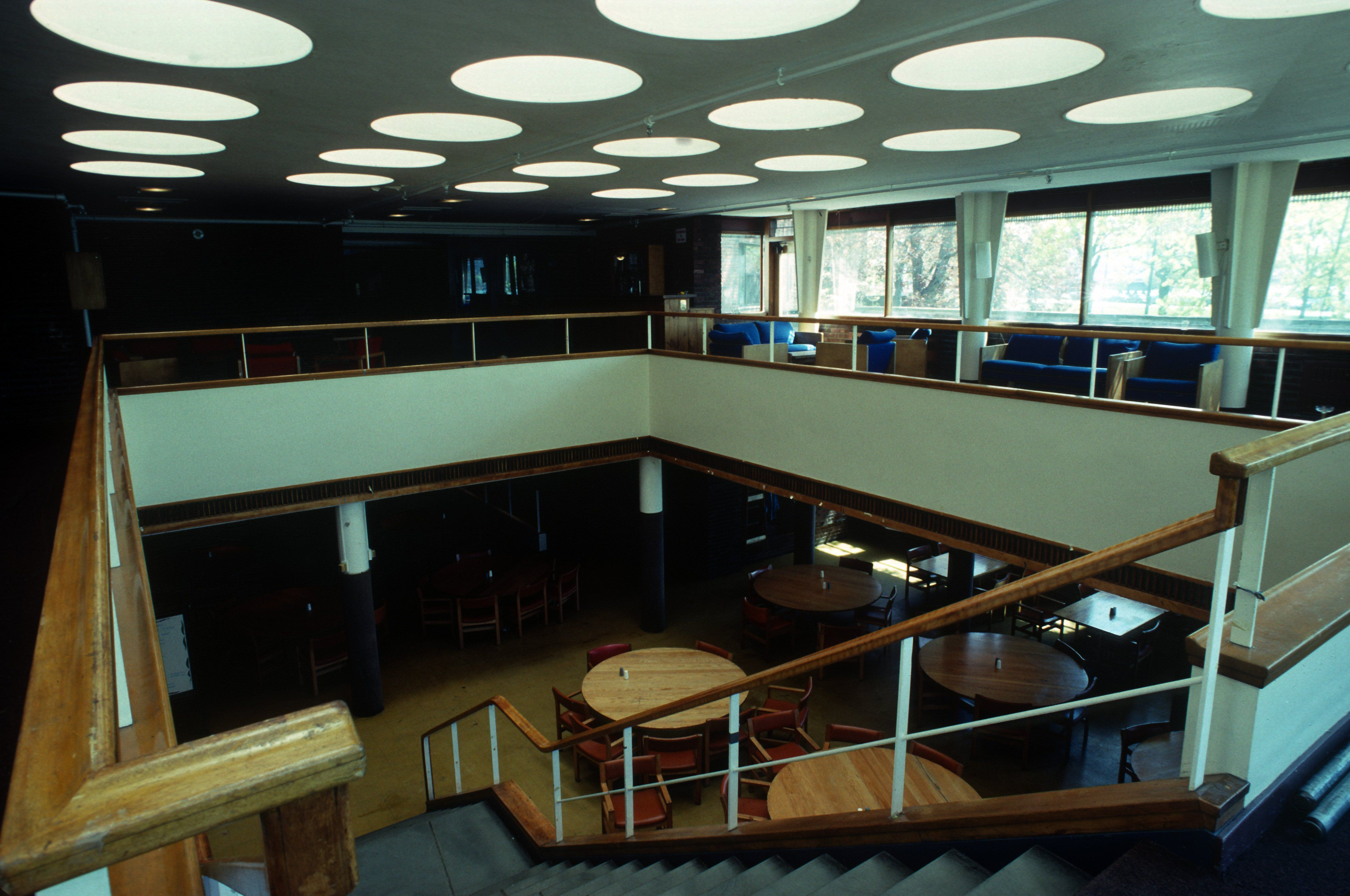 modern interior, two levels, open stairway, second floor opens to first, round lights on the ceiling