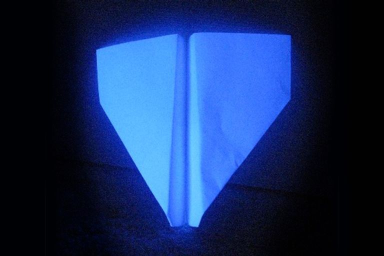 16 things that glow under black light ultraviolet light paper airplane leaning against wall under black light mozeypictures Gallery