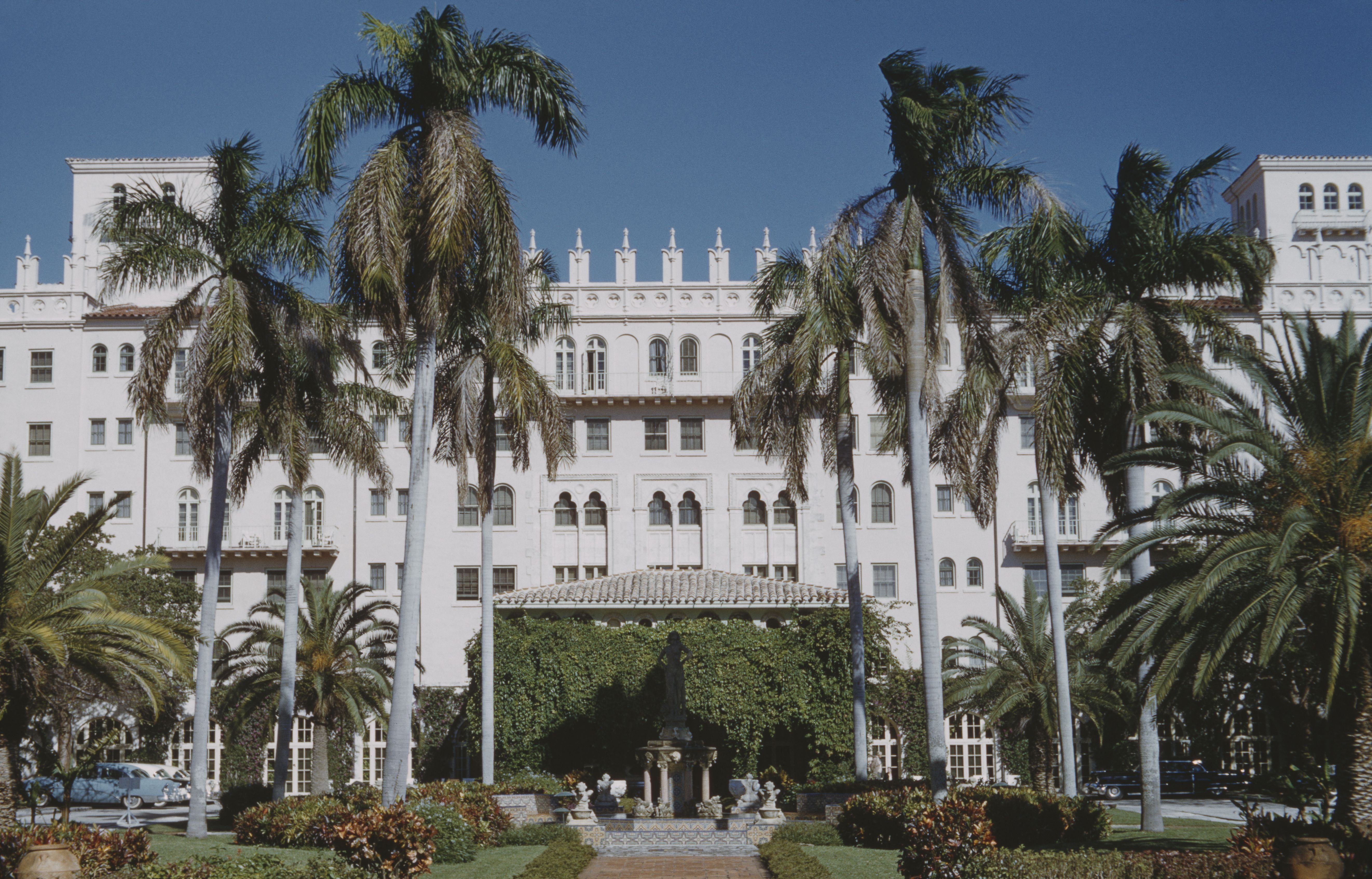 large, multi-story hotel, white color, ornate, arched windows