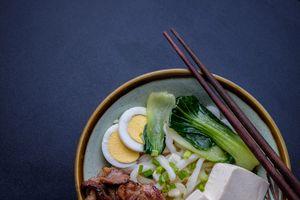 Japanese udon noodle bowl meal with chopsticks