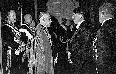Adolf Hitler converses with the Papal Nuncio, Archbishop Cesare Orsenigo.