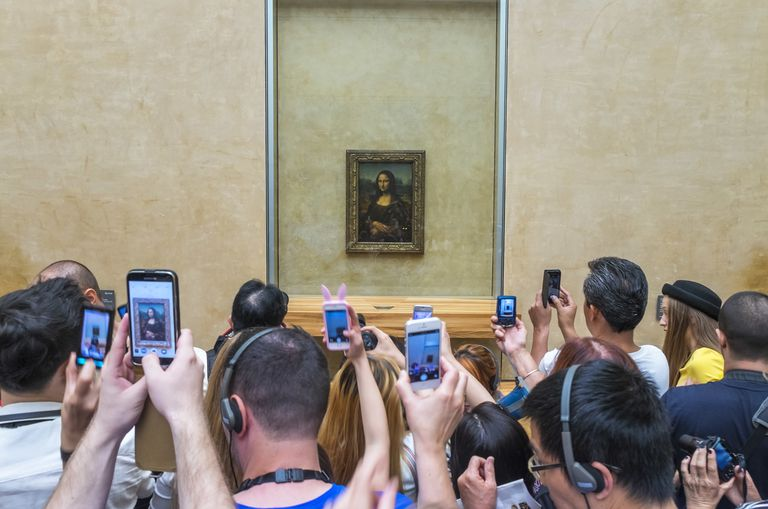 Tourists photographing Mona Lisa, The Louvre, Paris, France