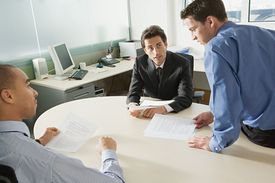 Business men in an office meeting