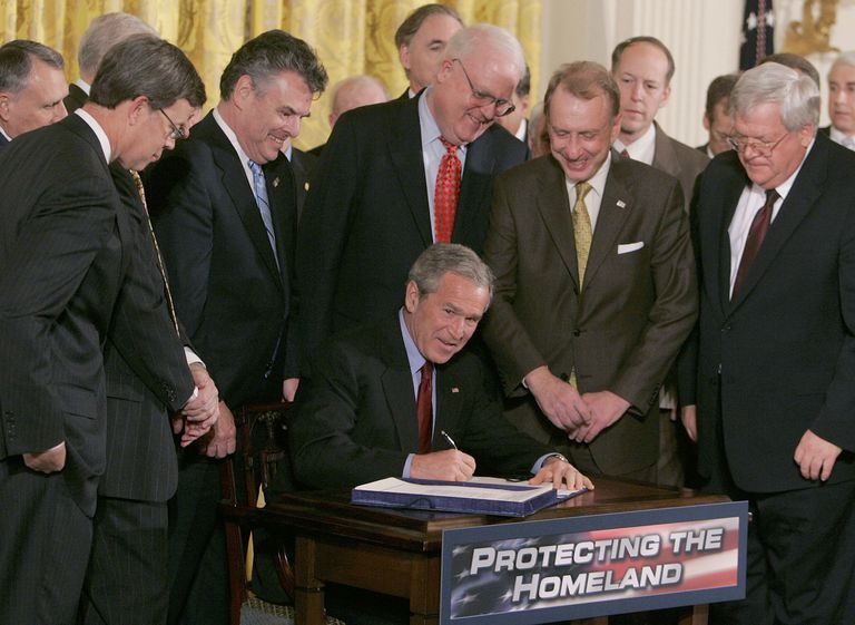 George W. Bush signs Patriot Act amongst peers