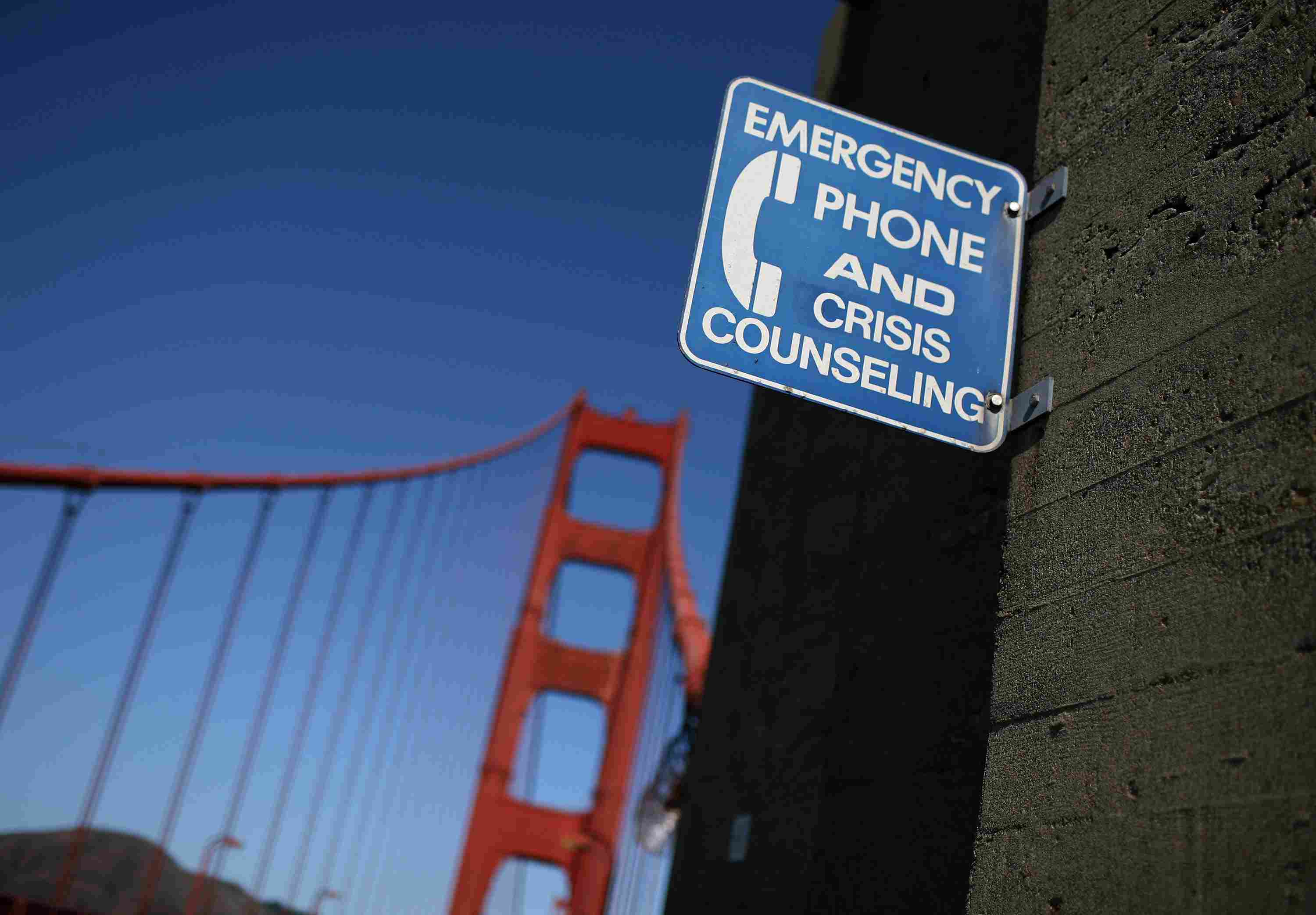 An emergency phone for crisis counseling sits on the Golden Gate Bridge in San Francisco, designed to prevent suicide. Sociologist Emile Durkheim found that there can be social rather than individual causes to suicide.