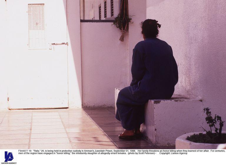 woman sitting looking at doorway