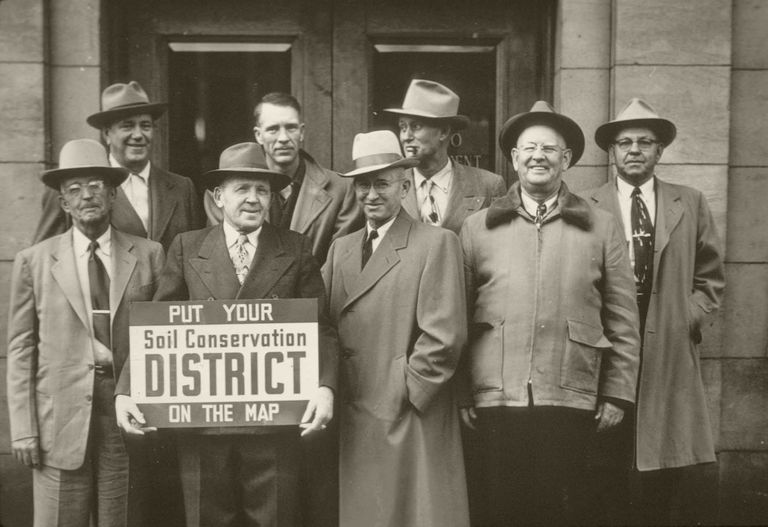 Men holding a Soil Conservation District sign