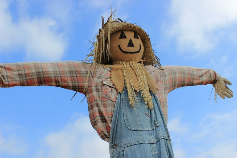 low-angle-view-scarecrow-against-cloudy-