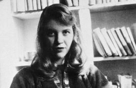 Photograph of Sylvia Plath in front of a bookshelf