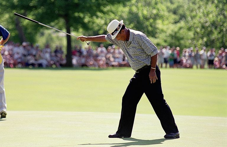 Chi Chi Rodriguez celebrates his putt during the U.S Senior Open at the Des Moines Country Club in Des Moines, Iowa on July 9, 1999