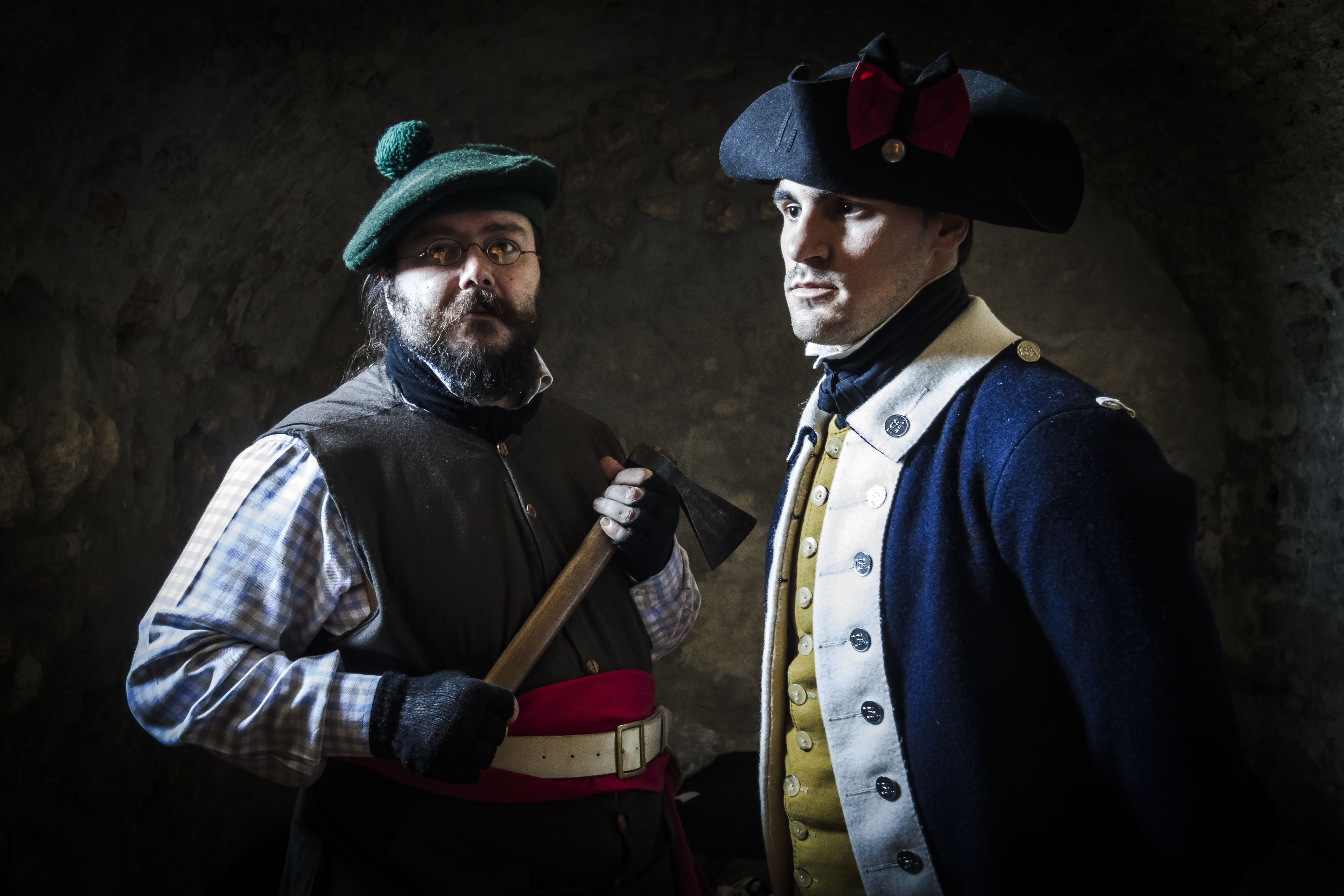 Two sergeants of 4th Massachusetts Regiment, one wearing wool cap and holding ax, and other wearing tricorn hat and blue uniform, American Revolutionary War, 18th century, Historical reenactment