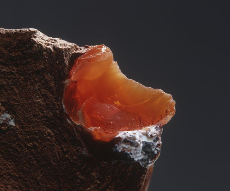 Pre-cut fire opal gemstone.