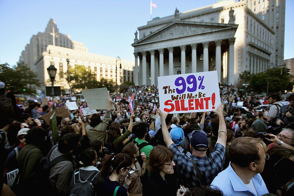 Protesters affiliated with the Occupy Wall Street movement march though Lower Manhattan on October 5, 2011.