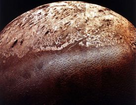 Triton, the largest moon of Neptune. The strange terrain along the center of the image is called