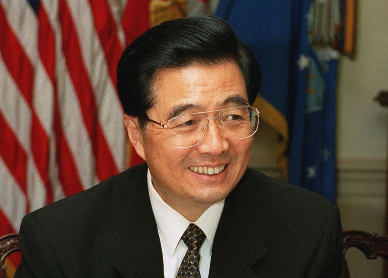 Hu Jintao at an official event, full color photograph.