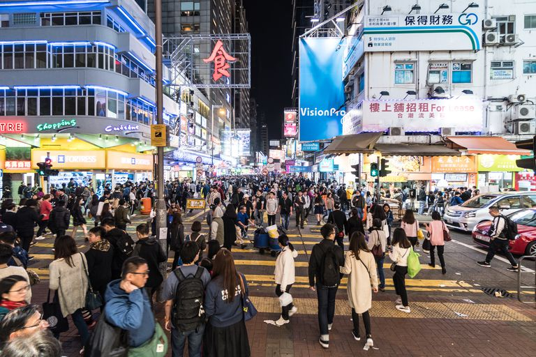 Crowded streets of Mongkok at night in Hong Kong