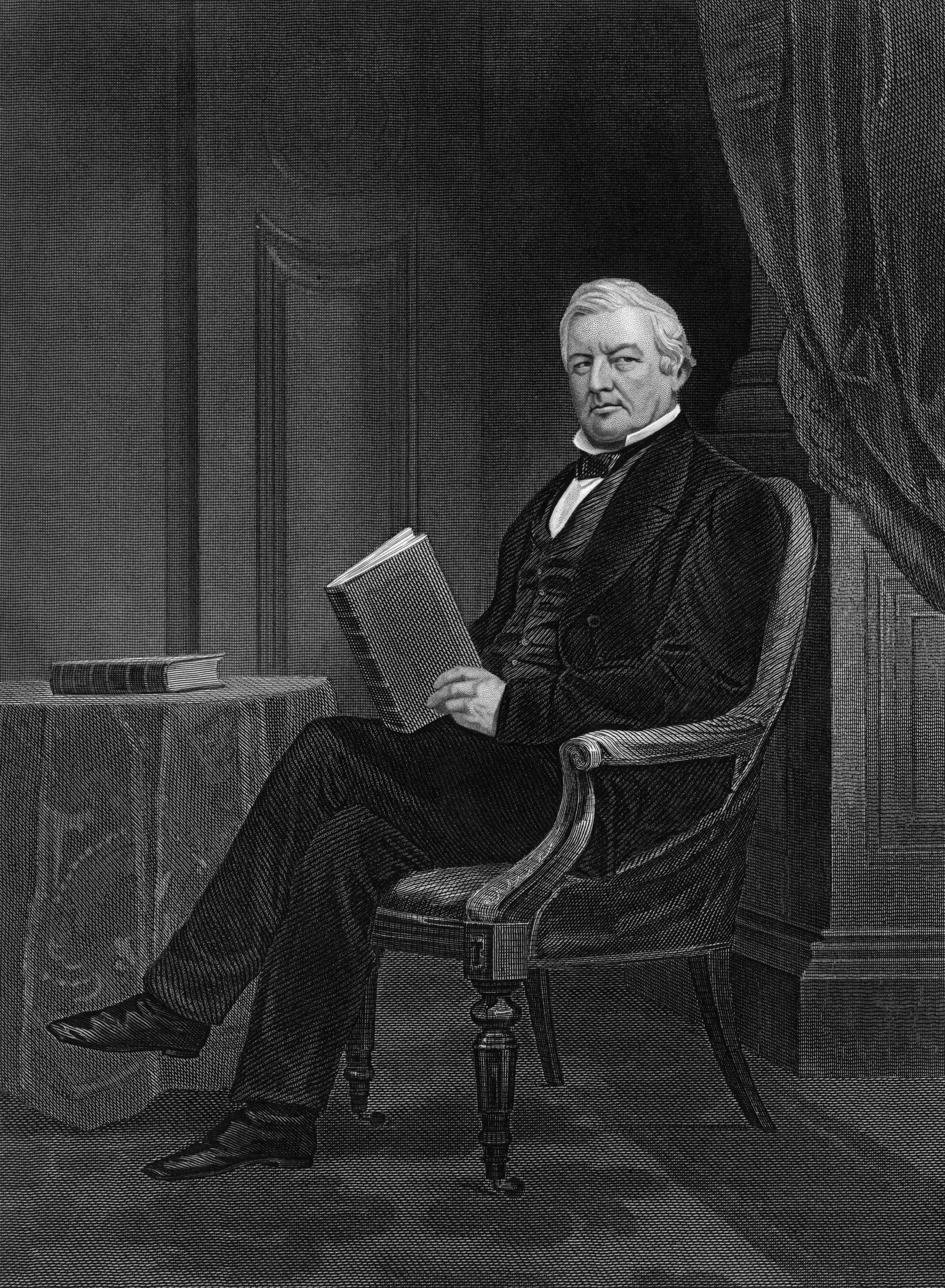 Millard Fillmore sitting with a book