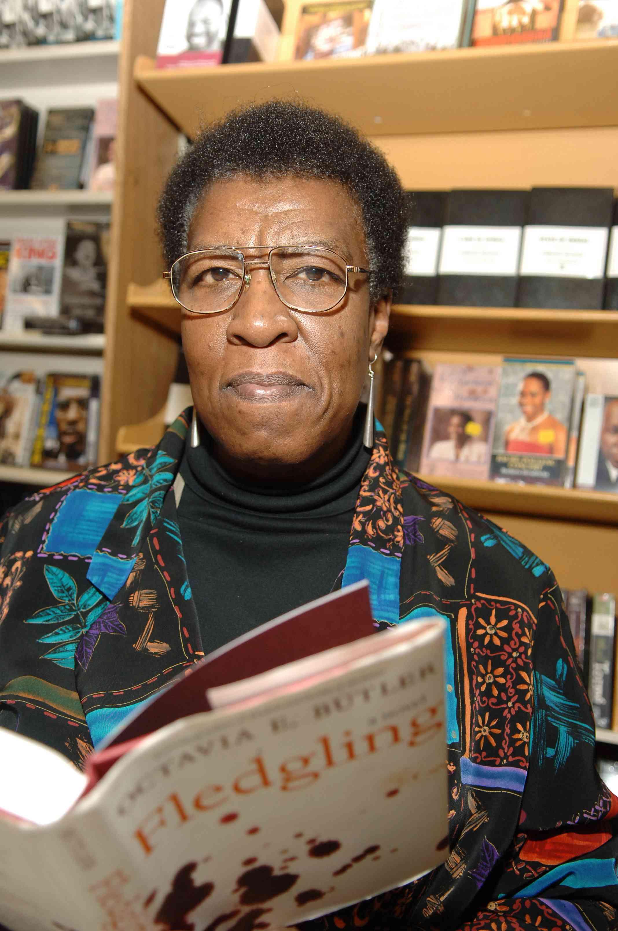 Octavia E. Butler with her novel Fledgling