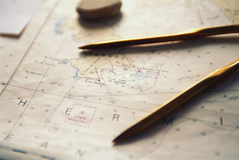 Close-up of nautical map and compass in ships map room