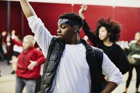 Dance instructor leading hip hop class in dance studio