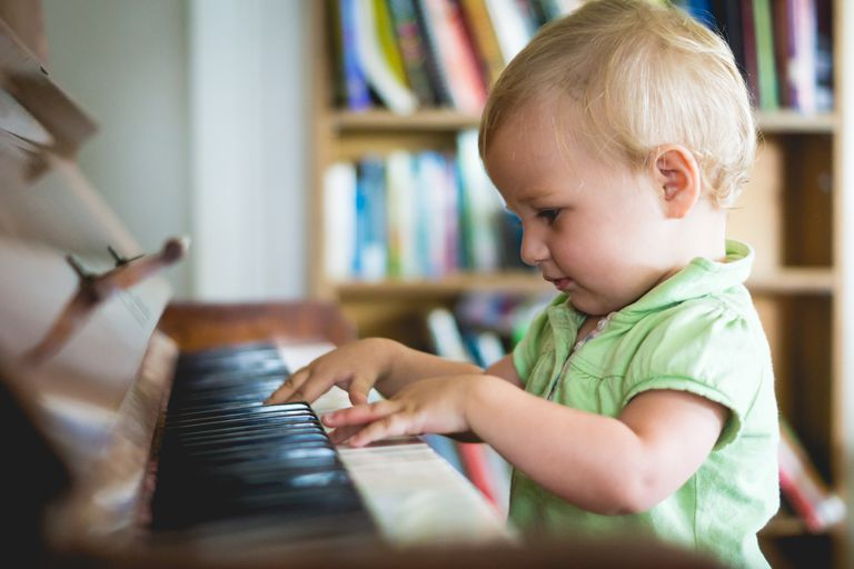 Young child playing piano