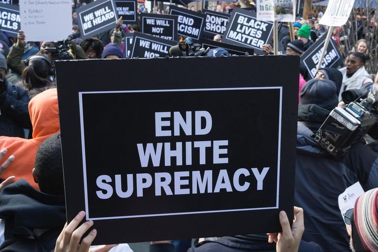 "A sign at a Black Lives Matter protest reads ""End White Supremacy"""
