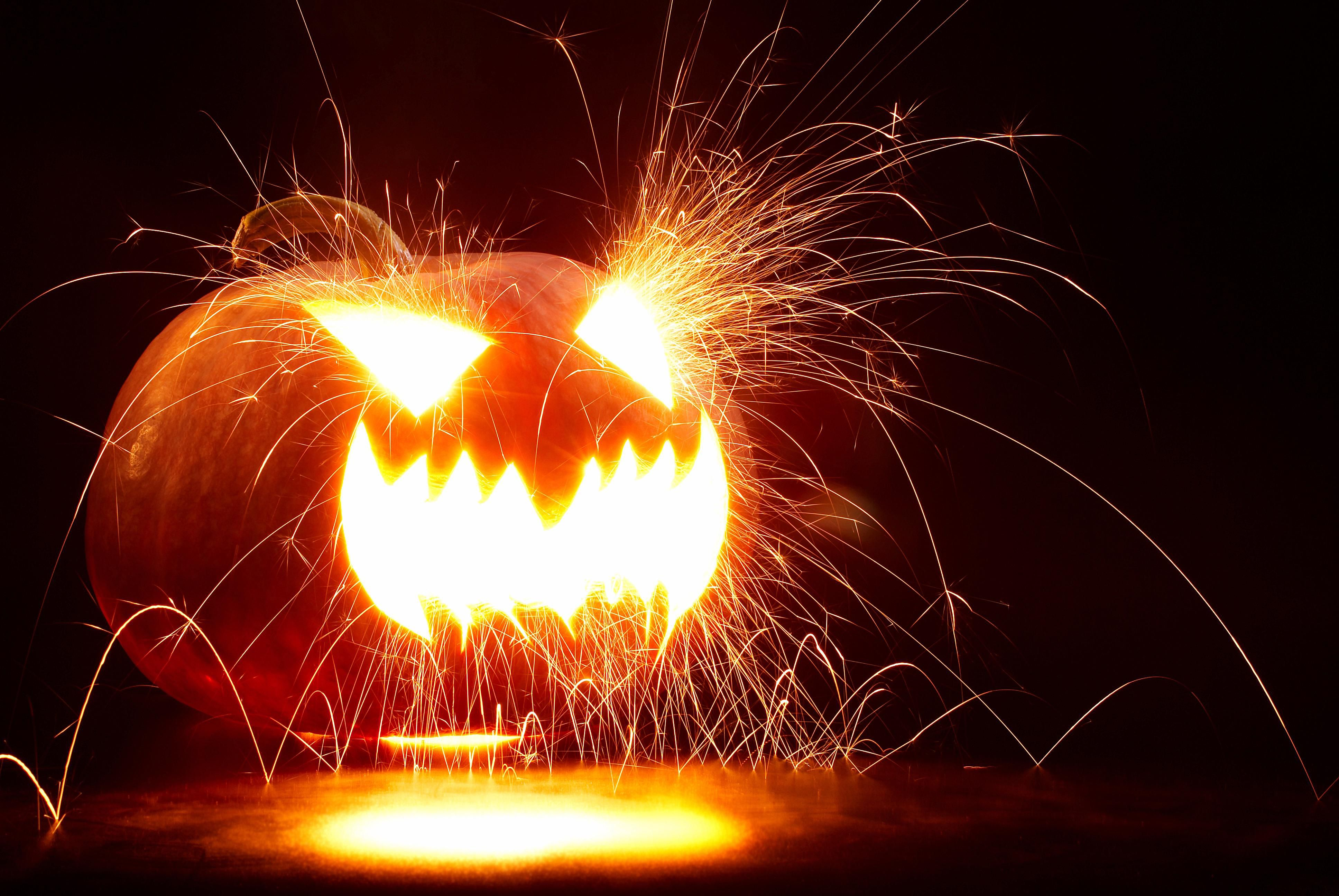 Igniting acetylene gas produced by a chemical reaction blows the face out of a pumpkin.