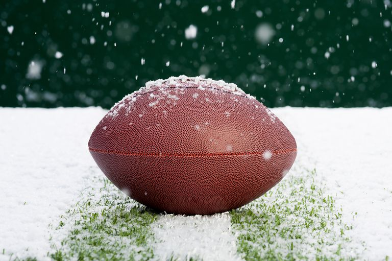 football on field in snow