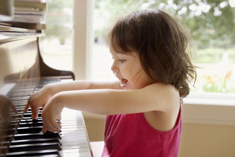 Girl (2-4) playing piano