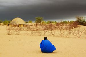 Storm clouds over traditional house in Mali