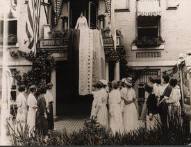 Alice Paul unfurls 36-star victory banner, August 18, 1920
