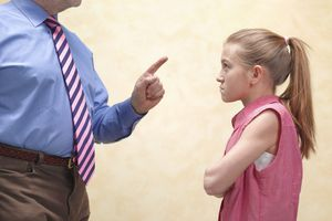 Young girl being scolded by an authority figure