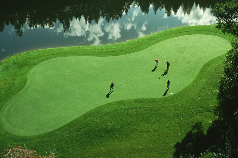 Four golfers on a green at Tamarron Hilton Resort