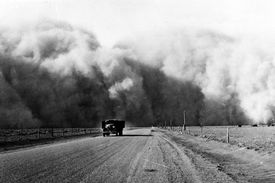South of Lamar, Colorado, a large dust cloud appears behind a truck traveling on highway 59, May 1936